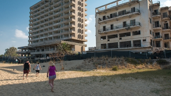 The empty buildings in Varosha have become just another feature of the landscape for Famagusta beachgoers [Wojtek Arciszewski/Al Jazeera]
