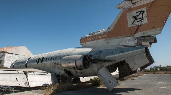 An abandoned plane rests at the old Nicosia Airport, which fell into disuse in 1974 and constitutes part of the UN buffer zone in Cyprus [Wojtek Arciszewski/Al Jazeera]